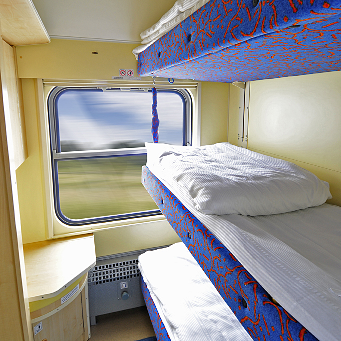 bed in a trains sleeping car 1